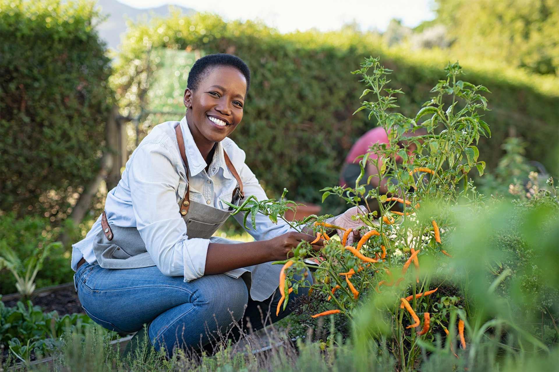 healthy woman gardening hero banner